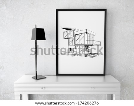 room and frame with drawing house on table - stock photo