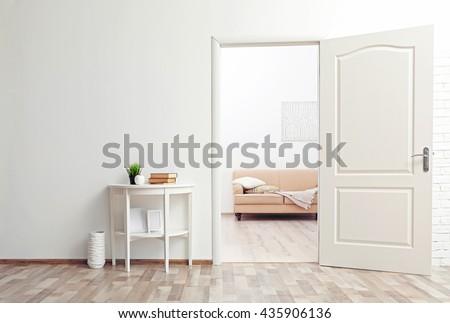 Room design interior with open door - stock photo