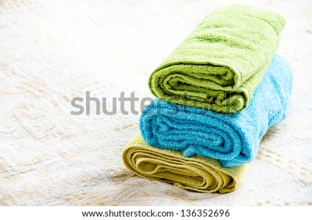 Room detail. Three towels on bed - stock photo