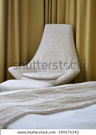 Room Details with Chair and Bed against Curtain Drapes - stock photo