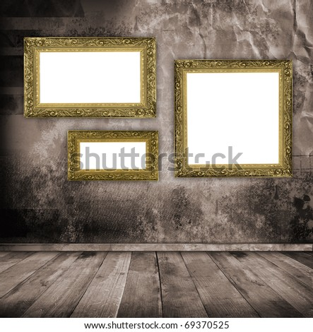 room interior vintage with empty retro frame on the wall - stock photo