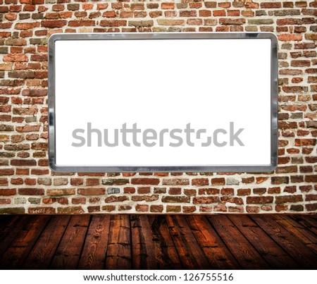 Room interior with huge blank billboard on brickwall - stock photo