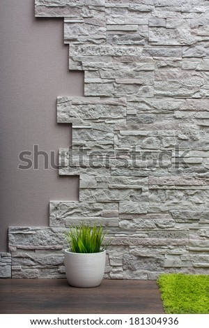 Room interior with stone wall, vinyl wallpaper and wood floor background. - stock photo