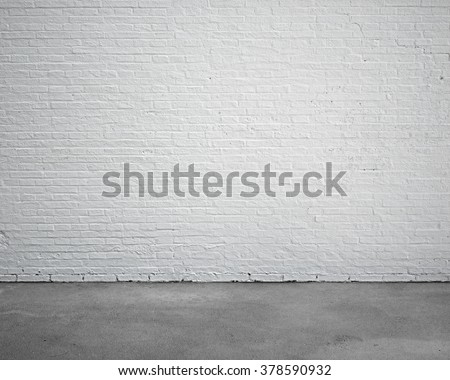 room interior with white brick wall and concrete floor, nobody, empty - stock photo
