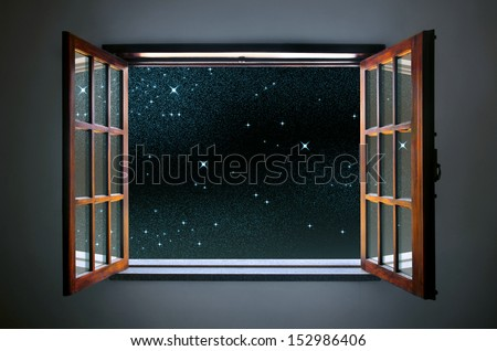 Room window wide open to a calm and clear starry night sky - stock photo