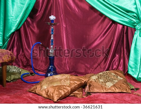 Room with a hookah and pile of pillows