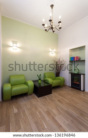 Room with an armchairs and a fireplace - stock photo