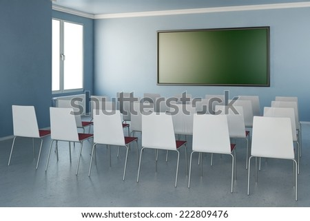 Room with chairs and green chalkboard and windows - stock photo