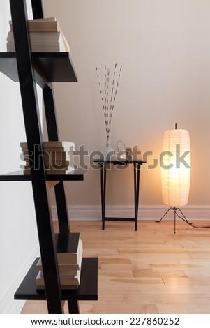 Room with contemporary decor, floor lamp and bookshelf. - stock photo