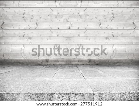 Room with floor from stone and wall from wooden planks - stock photo