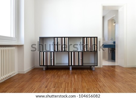 room with furniture, view of the bathroom, open door - stock photo