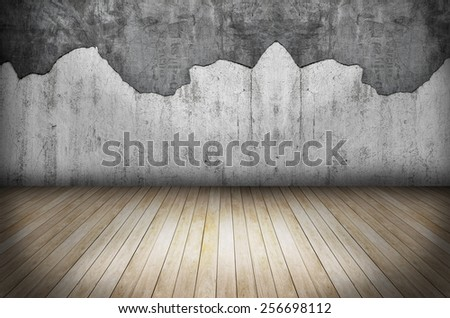 room with grunge stone wall and wooden floor  - stock photo