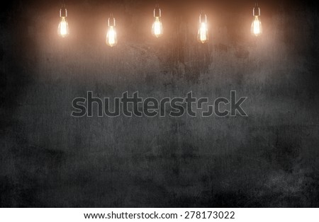room with pendant lamps and blackboard background - stock photo
