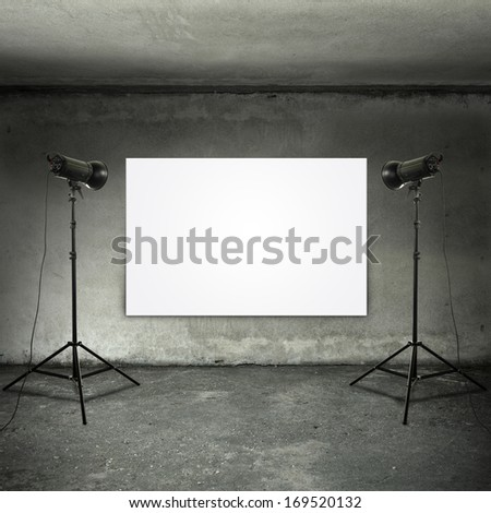 room with two lamps and white banner  - stock photo