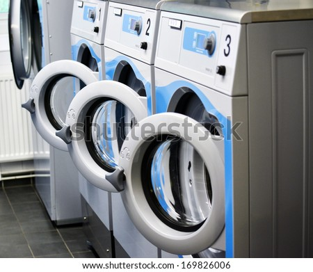 Room with washing machines - stock photo