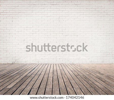 room with white bricks wall and wood floor - stock photo