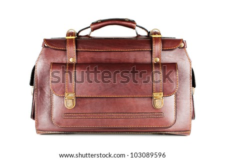 Roomy bag for traveling business of natural leather isolated on white background - stock photo