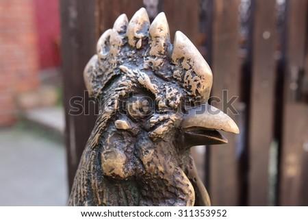 Rooster head, sculpture in bronze - stock photo