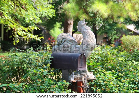 Rooster near a mail box - stock photo