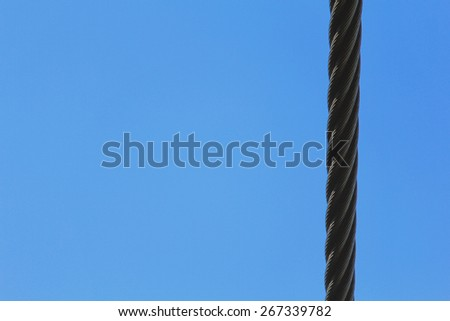 Rope against the blue sky . the power. cable. summer day. lift/Rope and blue sky - stock photo