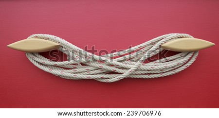 rope arrangement on wood wall - stock photo