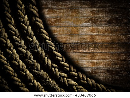 Rope background on grunge wooden texture background. - stock photo