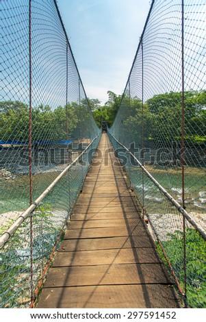 Rope bridge in Bukit lawang village, Sumatra, Indonesia - stock photo
