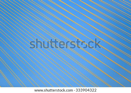 Rope bridge or cable sling of bridge with blue sky. Architecture abstract with rope bridge.