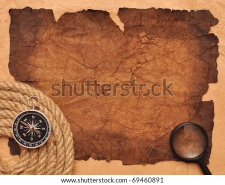 rope coil with compass on very old paper - stock photo