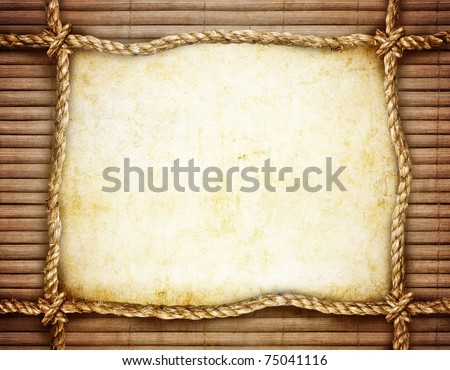 rope frame on bamboo background - stock photo