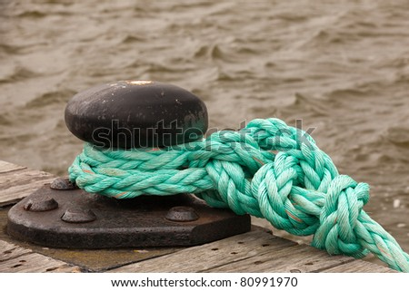 rope in the harbor - stock photo