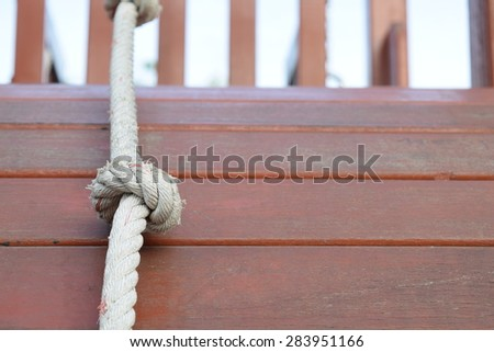 Rope knot on wooden floor background