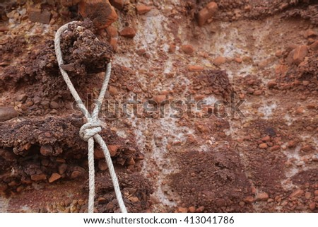rope noose hanging on the cliff - stock photo