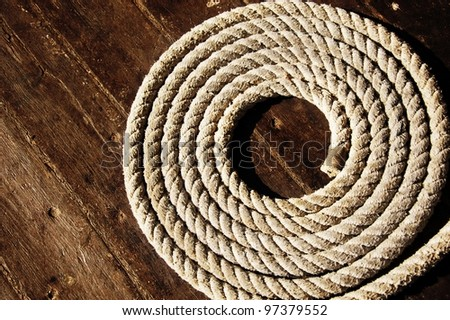 Rope on boat's deck. - stock photo