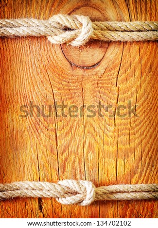 rope on the wooden background - stock photo