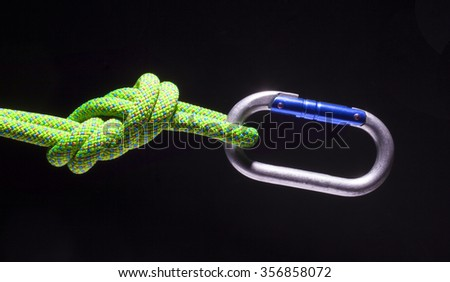 Rope tied in a figure eight with a carabiner at the end - stock photo