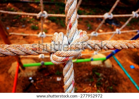 Rope tied in a knot - stock photo