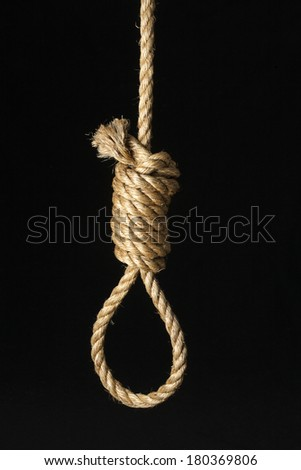 Rope tied in noose knot on black background - stock photo