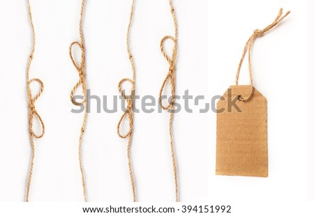 rope with a bow and tag on white background - stock photo