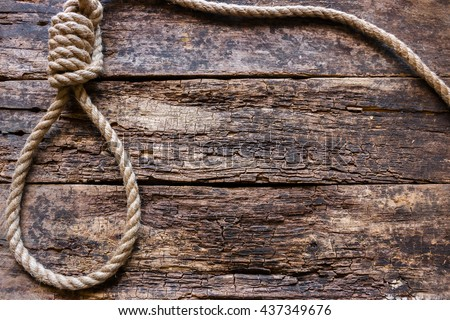 rope with a slipknot on the wooden background - stock photo