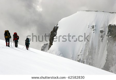 Roped Group of climbers - stock photo