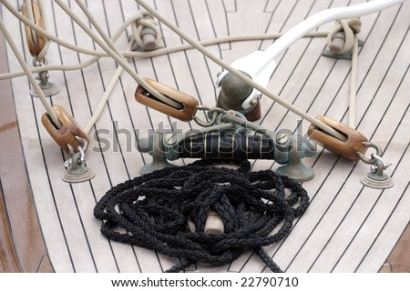 Ropes and winch and pulley on an old rig deck - stock photo