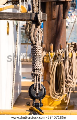 ropes and winches on a vintage sailing boat - stock photo