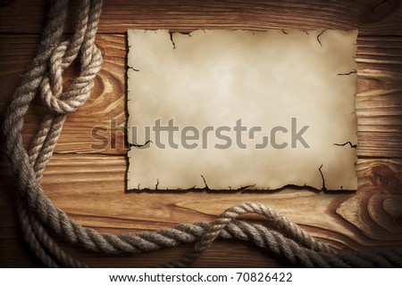 Ropes, old paper on a wooden background - stock photo