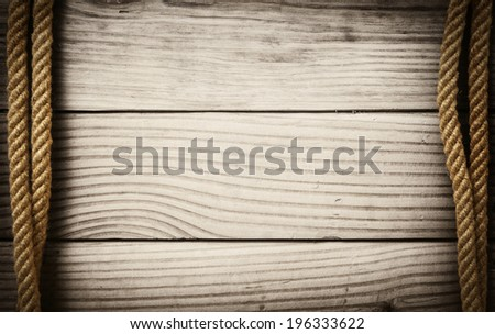 Ropes on wooden background - stock photo