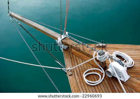 Ropes on wooden desk of an old sail boat - stock photo