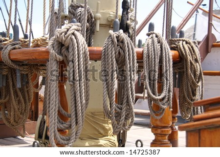 Ropes tied to the mast of an old tall ship - stock photo