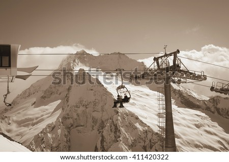 Ropeway at ski resort. Caucasus Mountains, region Dombay. Toned landscape.