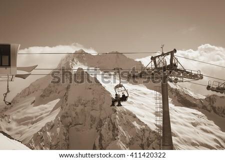 Ropeway at ski resort. Caucasus Mountains, region Dombay. Toned landscape. - stock photo
