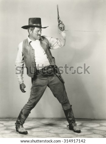 Roping in cowboy - stock photo